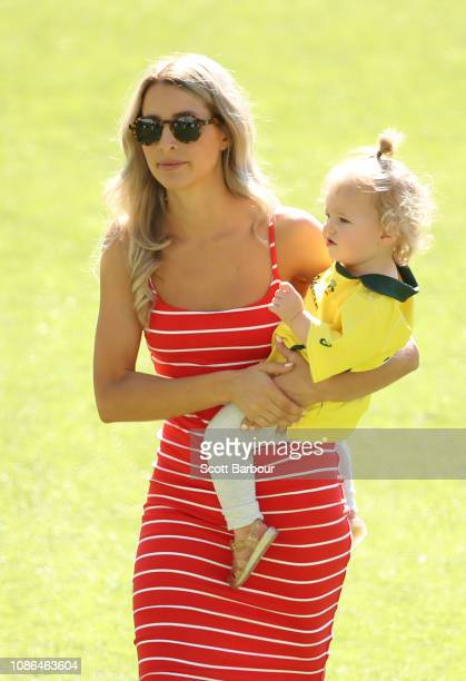 Bonnie Maggs the wife of Australian captain Tim Paine and their daughter Milla look on during an Australian training session at Melbourne Cricket...