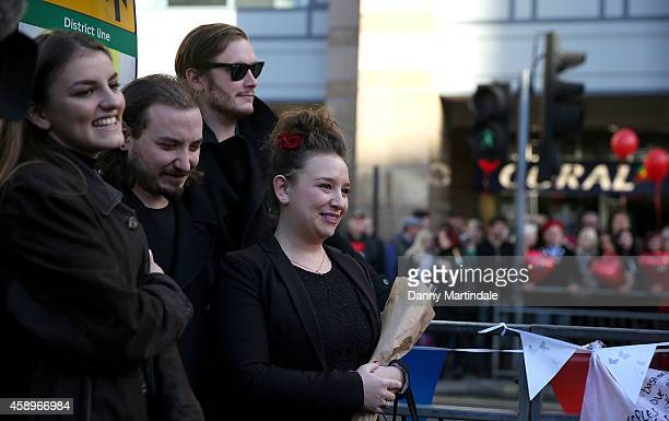 Bonnie Mayall Sidney Mayall and Rosie Mayall as a memorial bench for the late Rik Mayall is unveiled on November 14 2014 in London England