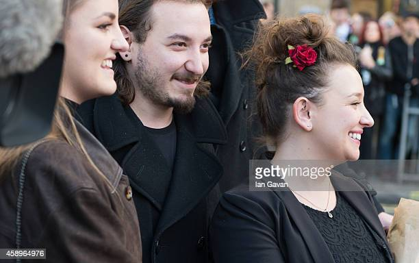 R Bonnie Mayall Sidney Mayall and Rosie Mayall attend as a memorial bench for the late Rik Mayall is unveiled on November 14 2014 in London England