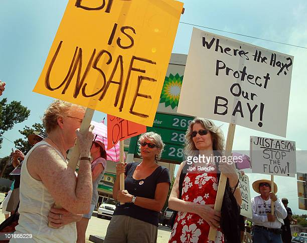 Bonnie McLean Pamela Corey and Bonnie Bayly protest against the BP oil company in front of a BP gas station as oil continues to flow from the...