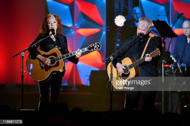 Bonnie Raitt and Inductee John Prine perform onstage during the Songwriters Hall Of Fame 50th Annual Induction And Awards Dinner at The New York...