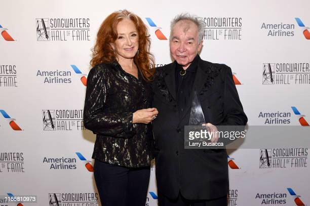 Bonnie Raitt and Inductee John Prine pose backstage during the Songwriters Hall Of Fame 50th Annual Induction And Awards Dinner at The New York...