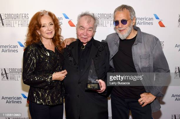 Bonnie Raitt and Inductees John Prine and Yusuf Islam pose backstage during the Songwriters Hall Of Fame 50th Annual Induction And Awards Dinner at...