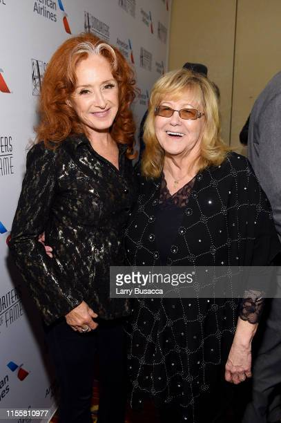 Bonnie Raitt and Linda Moran pose backstage during the Songwriters Hall Of Fame 50th Annual Induction And Awards Dinner at The New York Marriott...