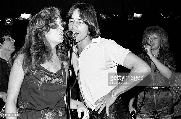 Bonnie Raitt Jackson Browne and Rosemary Butler performing at the No Nukes Muse Party at Trax in New York City on February 18 1980