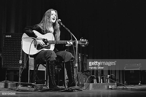 Bonnie Raitt performing as the opening act for The Byrds during a concert at Queens College in New York