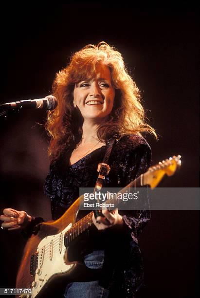 Bonnie Raitt performing at Farm Aid in Indianapolis, Indiana on April 7, 1990.