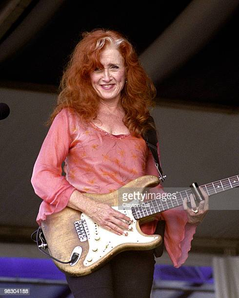 Bonnie Raitt performing with fender stratocaster at the New Orleans Jazz Heritage Festival on May 03 2002