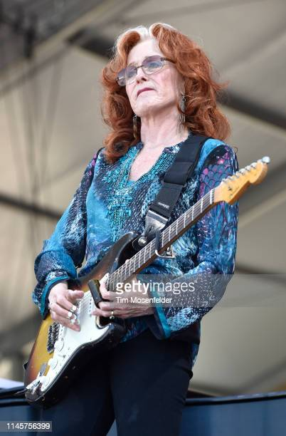 Bonnie Raitt performs during a tribute to Dave Batholomew and Fats Domino at the 2019 New Orleans Jazz Heritage Festival 50th Anniversary at Fair...