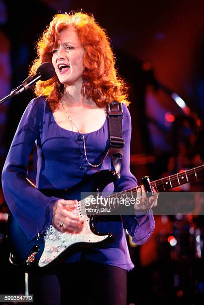 Bonnie Raitt Playing Guitar and Singing