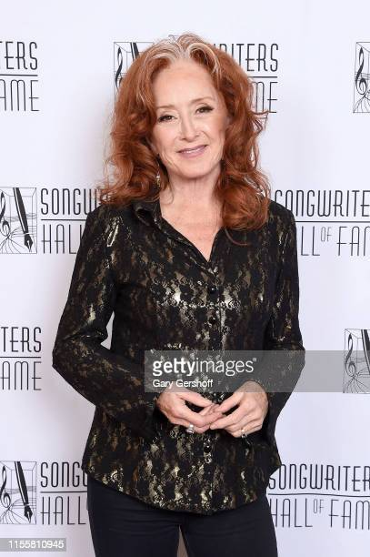 Bonnie Raitt poses backstage during the Songwriters Hall Of Fame 50th Annual Induction And Awards Dinner at The New York Marriott Marquis on June 13...