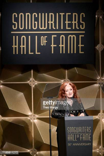 Bonnie Raitt speaks onstage during the Songwriters Hall Of Fame 50th Annual Induction And Awards Dinner at The New York Marriott Marquis on June 13...