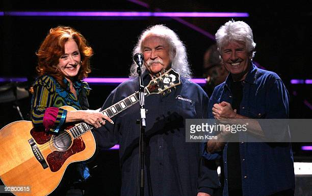 Bonnie Raitt with Graham Nash and David Crosby of Crosby Stills and Nash performs onstage at the 25th Anniversary Rock Roll Hall of Fame Concert at...
