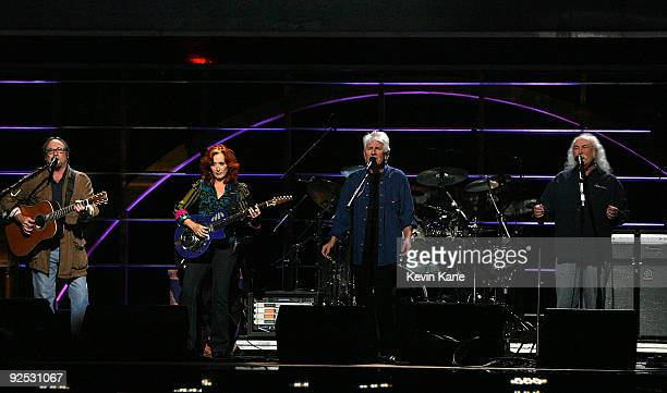 Bonnie Raitt with Stephen Stills Graham Nash and David Crosby of Crosby Stills and Nash perform onstage at the 25th Anniversary Rock Roll Hall of...