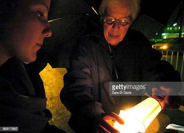 Bonnie Stone lights a candle for Washington DC resident Kristin Houle of Amnesty International at a vigil by death penalty opponents outside Central...