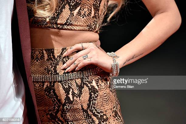 Bonnie Strange tatto and bracelet detail arrives at the GQ Men of the year Award 2016 at Komische Oper on November 10 2016 in Berlin Germany