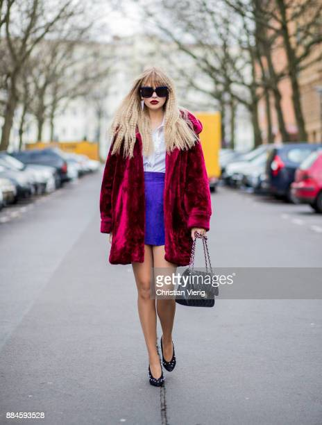 Bonnie Strange wearing a 80s look red vintage velvet coat black Escada vintage shoes and white blouse purple vintage skirt sunglasses black Chanel...
