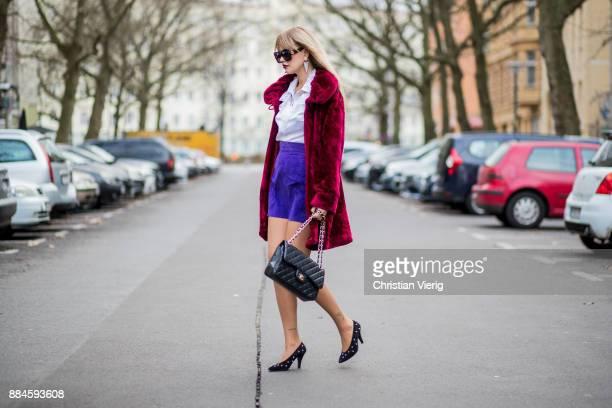 Bonnie Strange wearing a 80s look red vintage velvet coat black Escada vintage shoes and white blouse purple vintage skirt sunglasses black Chanel...