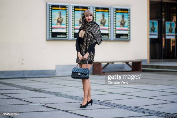 Bonnie Strange wearing a black Louis Vuitton scarf black Chanel bag black Weekday skirt black turtleneck Escada vintage skirt on December 2 2017 in...