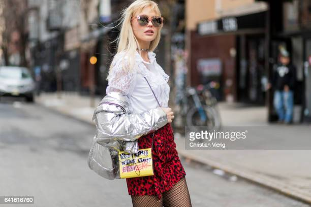 Bonnie Strange wearing a red Zara skirt, a silver Asos jacket, a white blouse Escada, black boots &other stories, Jimm Choo bag, net nights, Guess...