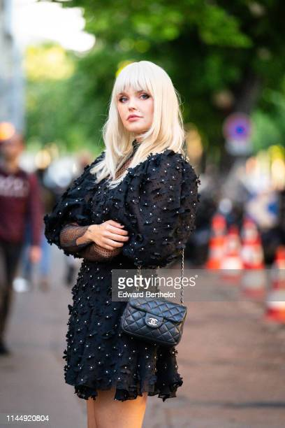 """Bonnie Strange wears a black mesh dress with embroidered flowers, a Chanel bag, outside the """"Scandal A Paris"""" : Jean-Paul Gaultier's New Fragance..."""