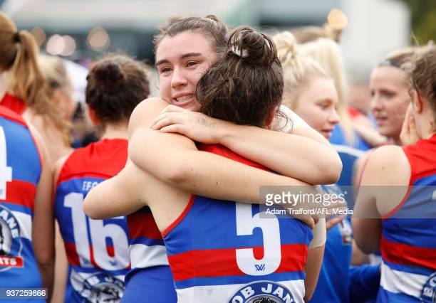 Bonnie Toogood of the Bulldogs celebrates with Emma Kearney of the Bulldogs during the 2018 AFLW Grand Final match between the Western Bulldogs and...