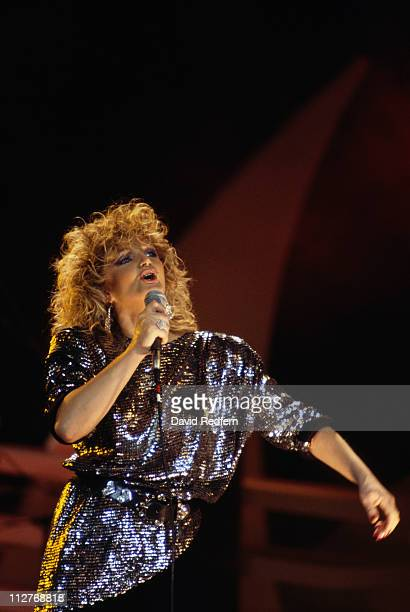 Bonnie Tyler British singer singing into a microphone during a live concert performance 1986