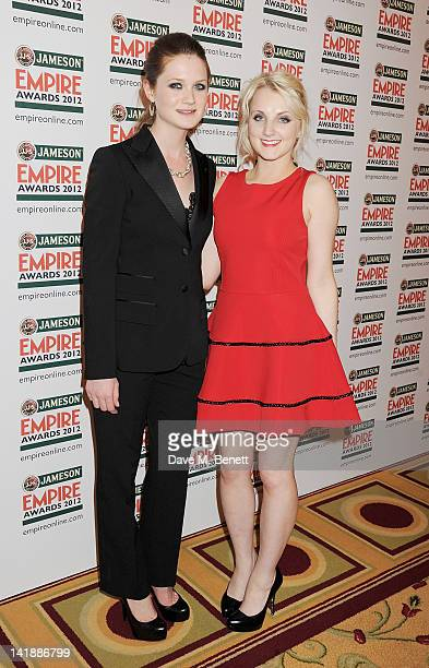Bonnie Wright and Evanna Lynch pose in the press room at the Jameson Empire Awards at Grosvenor House on March 25 2012 in London England