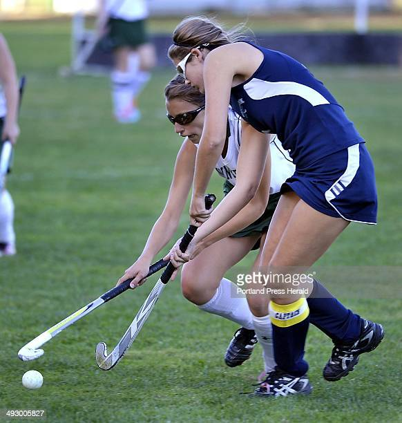 Bonny Eagle Nina Truslow and Westbrook Tori Winton battle for control as Bonny Eagle hosts Westbrook in girls high school field hockey action on...