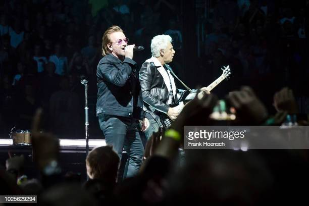 Bono and Adam Clayton of the Irish band U2 perform live on stage during a concert at the MercedesBenz Arena on August 31 2017 in Berlin Germany
