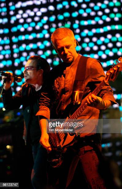 "Bono and Adam Clayton of U2 perform in support of the bands ""How to Dismantle an Atomic Bomb"" release at the Oakland Arena on November 8, 2005 in..."