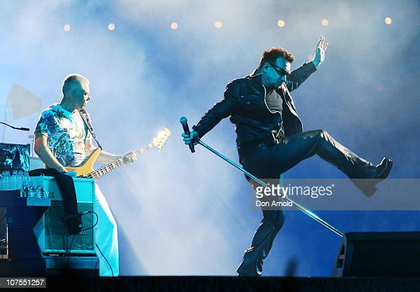 Bono and Adam Clayton of U2 perform on stage at ANZ Stadium on December 13 2010 in Sydney Australia