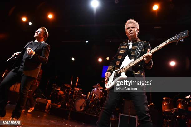 Bono and Adam Clayton of U2 perform on stage at the 13th Annual MusiCares MAP Fund Benefit Concert at the PlayStation Theater on June 26 2017 in New...