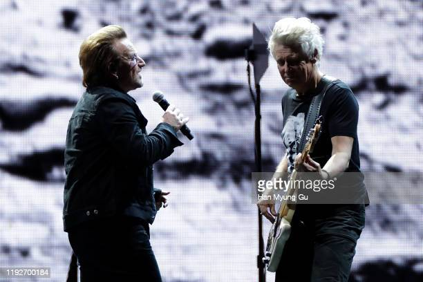 Bono and Adam Clayton of U2 perform on stage during 'U2 The Joshua Tree Tour 2019' at the Gocheok Sky Dome on December 08 2019 in Seoul South Korea