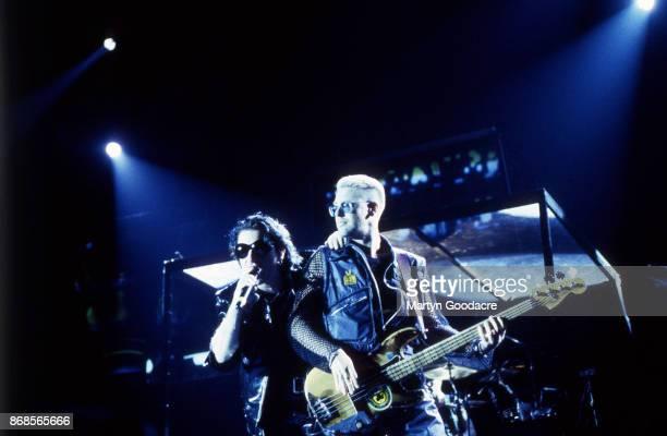Bono and Adam Clayton of U2 perform on stage on the Zoo TV Tour, Estadio Jose Alvalade, Lisbon, Portugal, 15 May 1993.