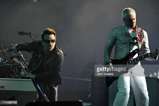 Bono and Adam Clayton perform during the U2 360 Tour at INVESCO Field at Mile High on May 21 2011 in Denver Colorado