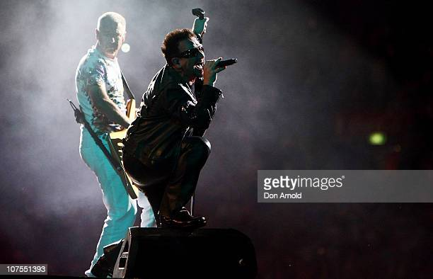 Bono and Adam Claytonof U2 perform on stage at ANZ Stadium on December 13 2010 in Sydney Australia