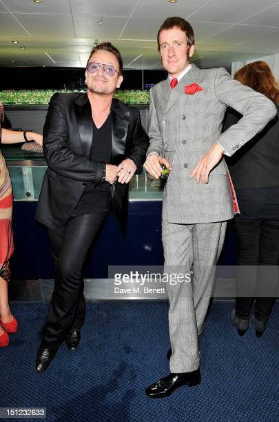 Bono and Bradley Wiggins arrive at the GQ Men Of The Year Awards 2012 at The Royal Opera House on September 4, 2012 in London, England.