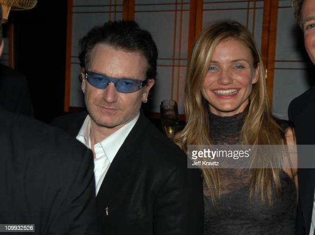 Bono and Cameron Diaz during Miramax 2003 Golden Globes Party Sponsored by Glamour Magazine and Coors at Trader Vic's in Beverly Hills CA United...