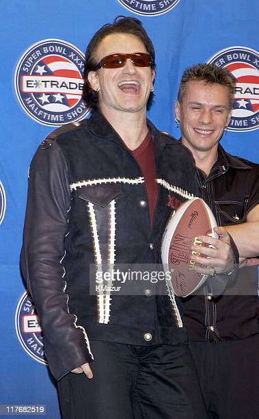 Bono and drummer Larry Mullen Jr of U2 attend a press conference January 30 2002 at the Superdome in New Orleans Louisiana days before their live...
