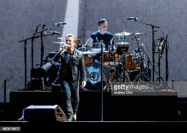 Bono and Larry Mullen Jr of rock band U2 perform on stage during their 'The Joshua Tree World Tour' opener at BC Place on May 12 2017 in Vancouver...