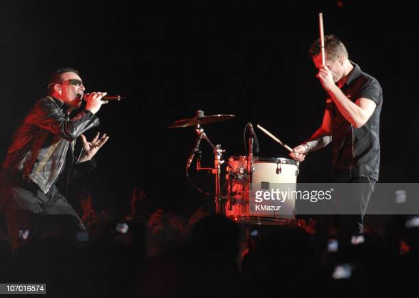 Bono and Larry Mullen Jr of U2 during U2 in Concert in Honolulu December 9 2006 at Aloha Stadium in Honolulu Hawaii United States
