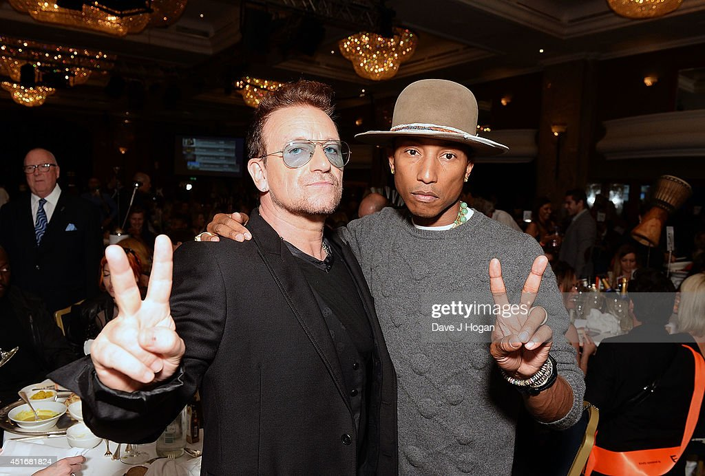 Bono and Pharrell Williams attend the Nordoff Robbins 02 Silver Clef awards at London Hilton on July 4, 2014 in London, England.