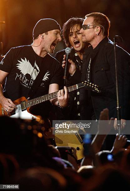 Bono and The Edge of U2 and Billie Joe Armstrong of Green Day perform prior to the Monday Night Football game between the Atlanta Falcons and the New...