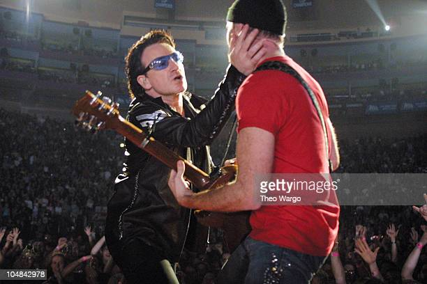 Bono and The Edge of U2 during U2 Elevation Tour 2001 NYC at Madison Square Garden at Madison Square Garden in New York City New York United States