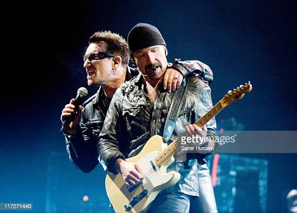 Bono and The Edge of U2 headline the Pyramid Stage at the Glastonbury Festival at Worthy Farm Pilton on June 24 2011 in Glastonbury England The...