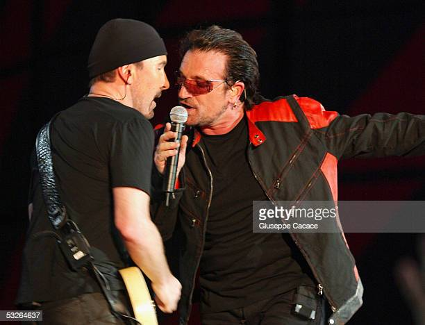 Bono and The Edge of U2 perform on stage during their Vertigo tour 2005 at the San Siro Stadium on July 20 2005 in Milan Italy