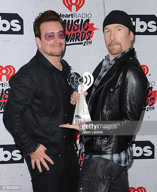 Bono and The Edge of U2 pose in the press room at the iHeartRadio Music Awards at The Forum on April 3 2016 in Inglewood California