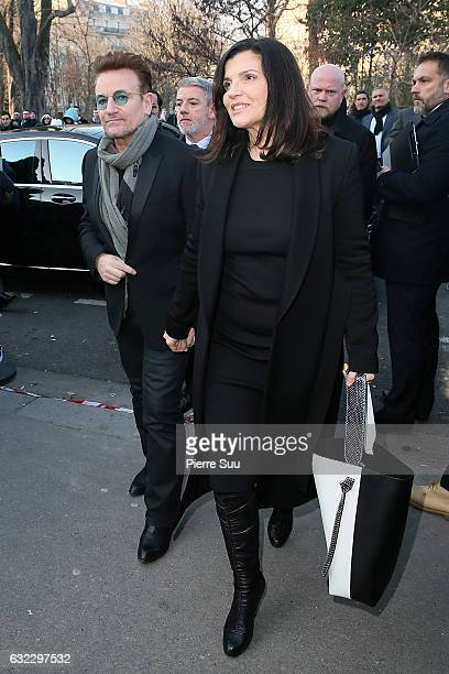Bono and wife Ali Hewson attend the Dior Homme Menswear Fall/Winter 20172018 show as part of Paris Fashion Week on January 21 2017 in Paris France