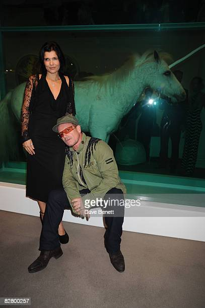 Bono and wife Ali Hewson pose as Sotherby's host artist Damien Hirst's largest body of work to be seen and auctioned for many a year at Sotherby's...